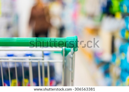 Shopping cart in supermarket. - stock photo