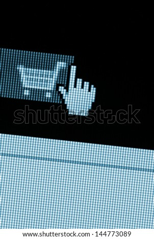 Shopping cart in the online store on a computer monitor. - stock photo