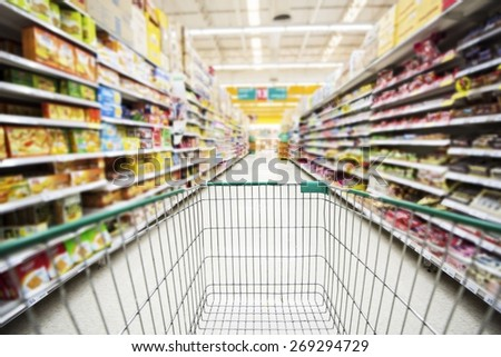 Shopping cart in the supermarket. - stock photo