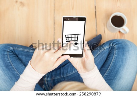shopping cart on a smartphone - stock photo