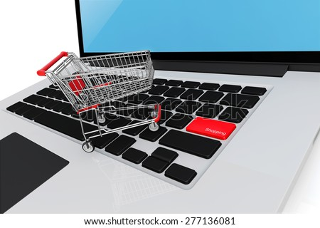 Shopping cart on laptop keyboard, E-commerce, internet shopping, the symbol of e-commerce with clipping path, online shopping concept. - stock photo