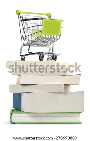 shopping cart on top of a stack of books - stock photo