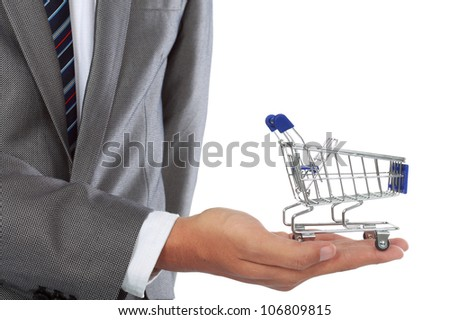 shopping cart on top of hands isolated over white background - stock photo