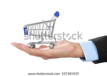 shopping cart on top of hands isolated over white background