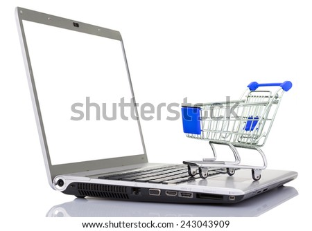 Shopping cart over a laptop computer, isolated on white background - stock photo
