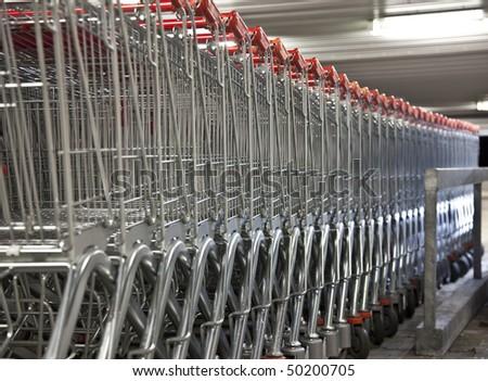 shopping cart row - stock photo