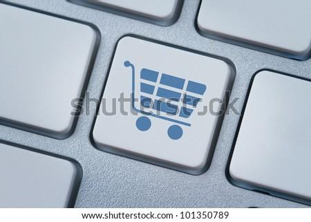 Shopping cart symbol at the computer key - stock photo