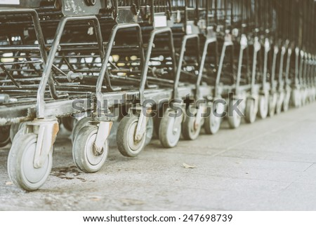 Shopping cart wheel - vintage effect style pictures - stock photo
