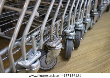 Shopping cart wheels - stock photo