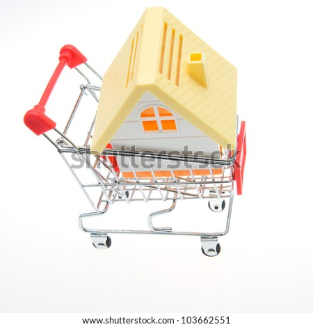 Shopping cart with a house.
