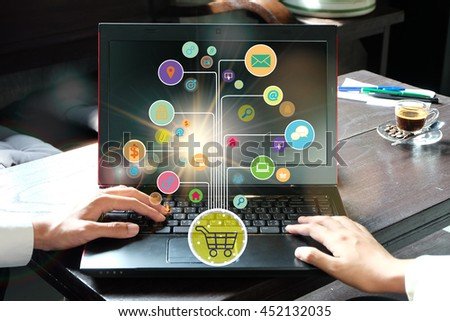 shopping cart with application software icons on laptop , business online concept