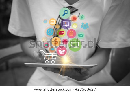 shopping cart with application software icons on tablet, black and white background image  , business concept, shopping online concept , business idea,online shopping, marketing online,