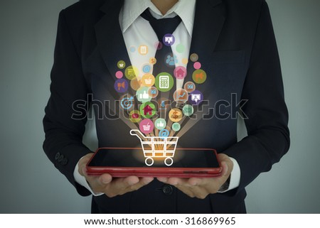 shopping cart with application software icons on  tablet computer  , business concept - stock photo