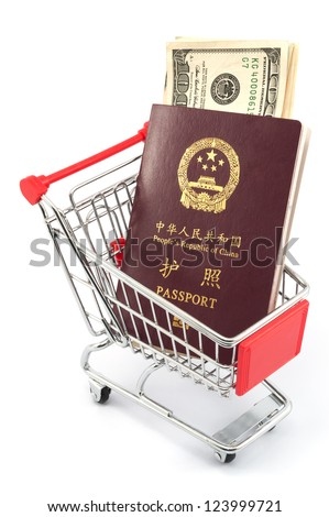 Shopping cart with chinese passport and dollars on white background - stock photo
