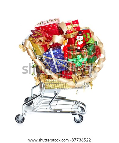 Shopping cart with Christmas gifts and presents. Isolated over white background.