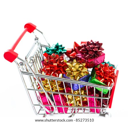Shopping cart with colorful christmas gift boxes isolated on white background
