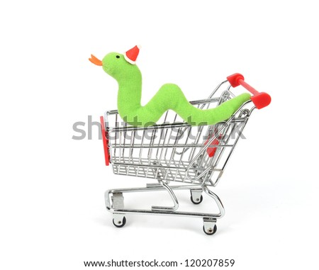 Shopping cart with Cute Christmas snake - stock photo