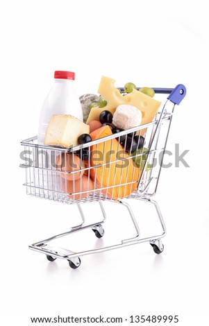 shopping cart with dairy product - stock photo