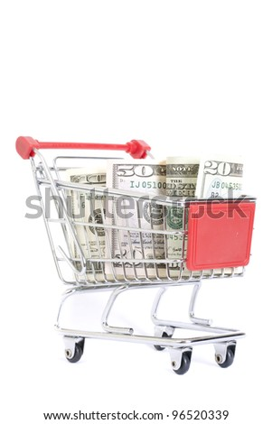 shopping cart with dollar banknotes on white - stock photo