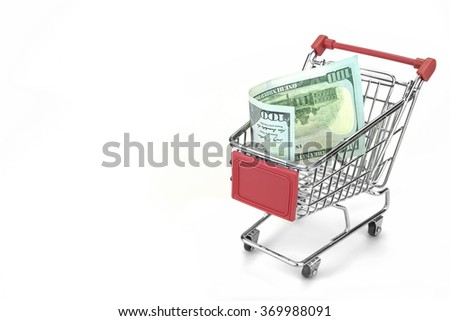 Shopping Cart With Dollar Cash And Red Advertising Display Isolated On White Background, Closeup, Buyer Activity Concept - stock photo
