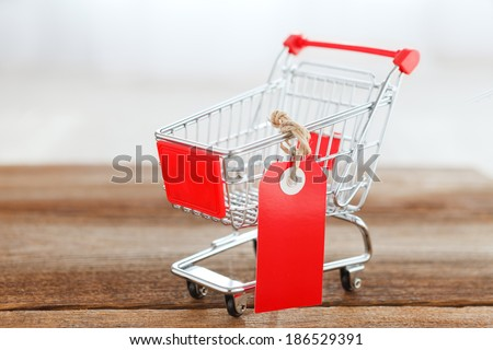 shopping cart with empty price tag - stock photo