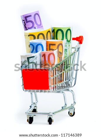 shopping cart with euro banknotes on white bockgraund - stock photo