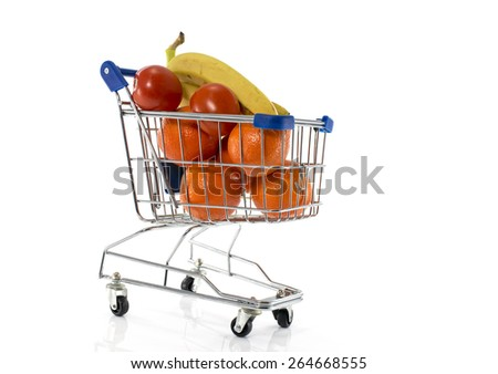 shopping cart with fresh fruit as bananas oranges and red tomato