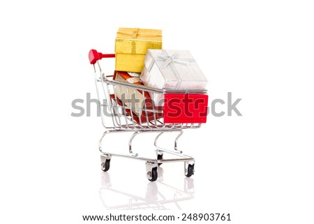 Shopping cart with gift - Valentines day e-commerce concept - stock photo
