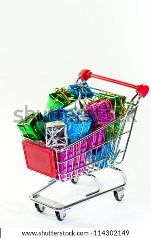 Shopping cart with gifts isolated on white background