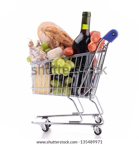 shopping cart with groceries - stock photo