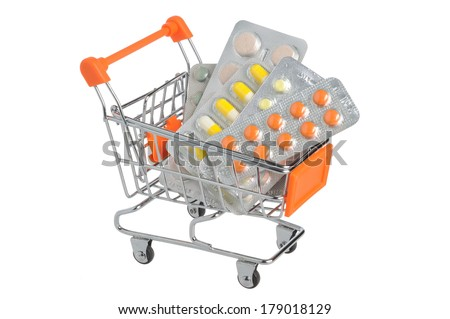 Shopping cart with medical supplies isolated on white background - stock photo