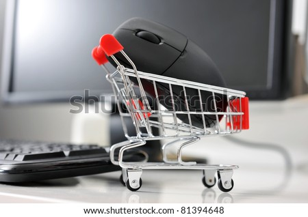shopping cart with mouse in front of computer , online shopping concept. - stock photo