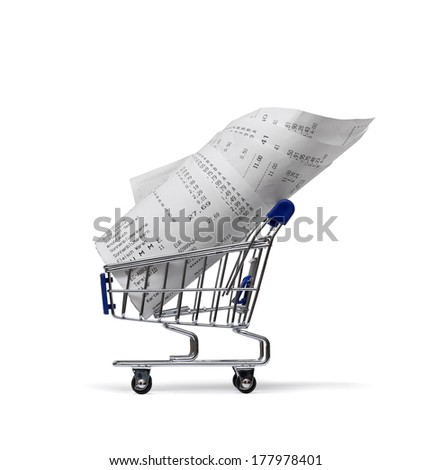 Shopping cart with receipts on white  - stock photo