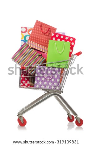 Shopping cart with supermarket basket - stock photo