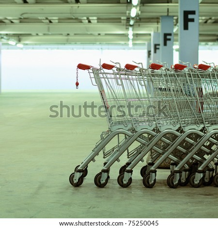 Shopping carts in a shopping mall basement parking - stock photo