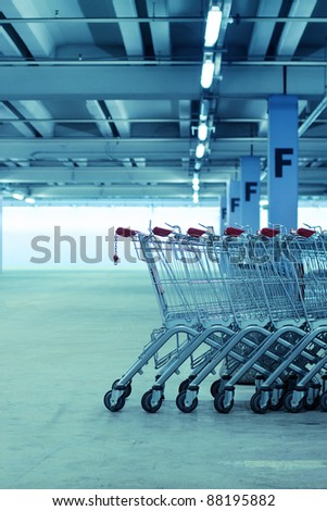 Shopping carts in the underground parking lot - stock photo