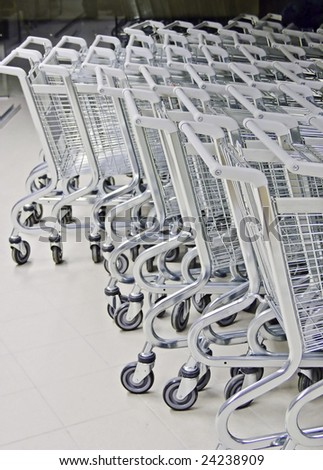 shopping carts in warehouse - stock photo