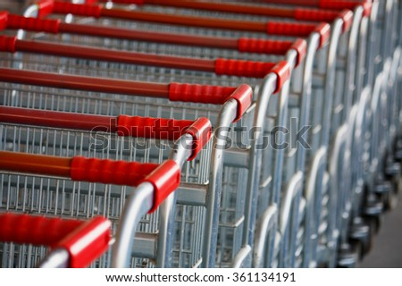 Shopping carts on a parking lot - stock photo