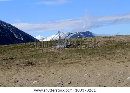 shopping carts overturned in the mountains - stock photo