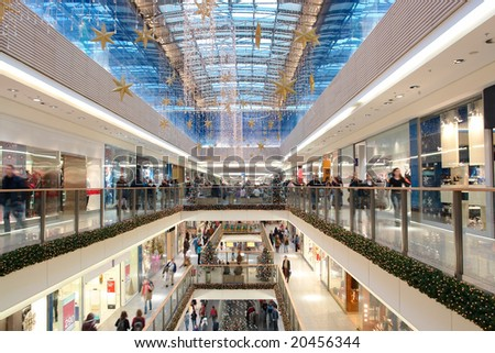 Shopping center decorated with christmas ornaments and lights - stock photo