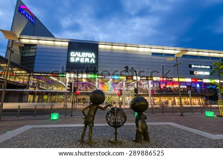 SHOPPING CENTER SFERA, BIELSKO-BIALA, POLAND - JUNE 16: Bolek & Lolek cartoon characters in front of shopping center, June 16, Bielsko-Biala, Poland. Mall was build in two steps - 2001 and 2009 year - stock photo