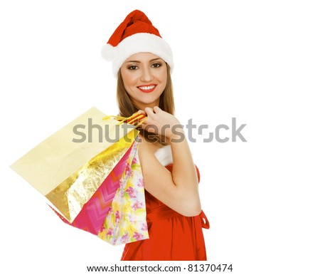 Shopping Christmas woman smiling. Isolated over white background - stock photo