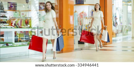 Shopping Collage. Portrait of a young beautiful women on the background showcases a shoe store - stock photo