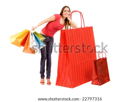 Shopping concept by woman with bags lean on red bag. - stock photo