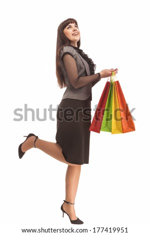 Shopping Concept: Happy Exclaiming Caucasian Woman With Color Bags. Isolated Over White. Vertical Image