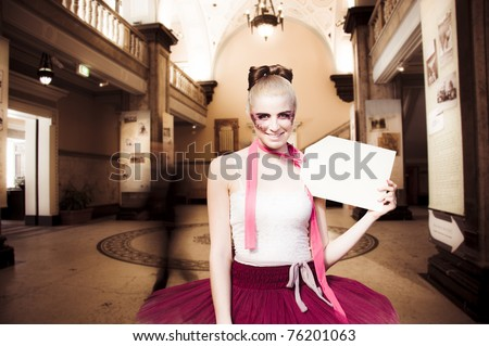 Shopping Concept With A Female Mannequin Wearing Ballerina Tutu Standing In A Shop Or Shopping Center Holding A Price Tag With Text Copy Space - stock photo