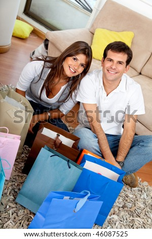 Shopping couple at home looking at their purchases