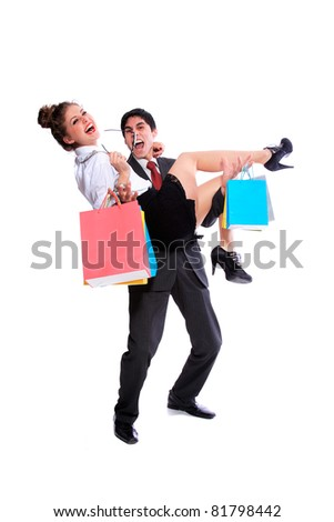Shopping couple smiling and having fun . Isolated over white background - stock photo