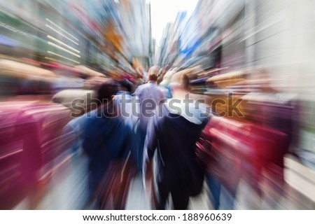 shopping crowd in the busy street of the city with creative zoom effect - stock photo