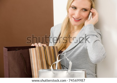 Shopping fashion woman on phone in designer clothes with bag